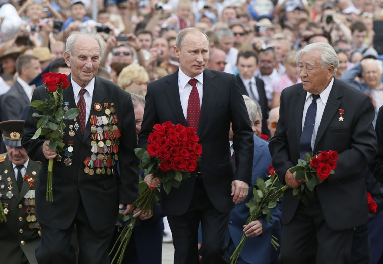 Russian President Vladimir Putin (center) and World War II veterans attend in a flowers-laying ceremony at the Battle of Prokhorovka monument at the State Military-Historical Museum of Prokhorovka Field, in southern Russia, on July 12, 2013. The 1943 Battle of Prokhorovka was fought near the settlement of Prokhorovka, 54 miles (87 km) southeast of Kursk, on the Eastern Front during the Second World War as part of the Battle of Kursk in the Soviet Union. The Wehrmacht's II SS Panzer Corps clashed with the Red Army's 5th Guards Tank Army. It is regarded as one of the largest tank battles in military history. (Yuri Kochetkov/AFP/Getty Images)
