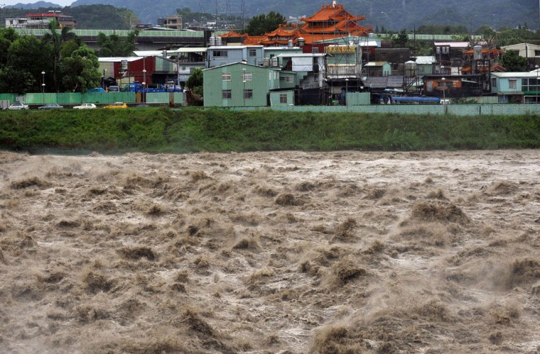 A turbulent river is seen during typhoon Soulik in Taipei on July 13, 2013. (Mandy Cheng/AFP/Getty Images)