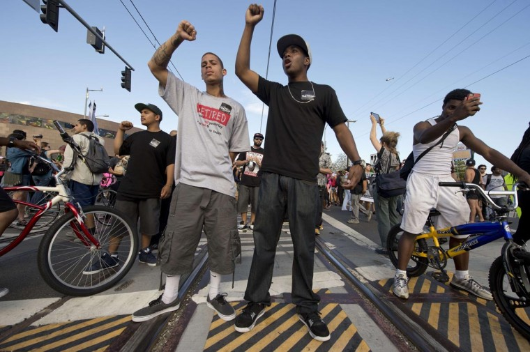 Americans angry at the acquittal of George Zimmerman in the death of black teen Trayvon Martin stand on train tracks to block trains in protest in Los Angeles, California July 14, 2013. (Robyn Beck/AFP/Getty Images)