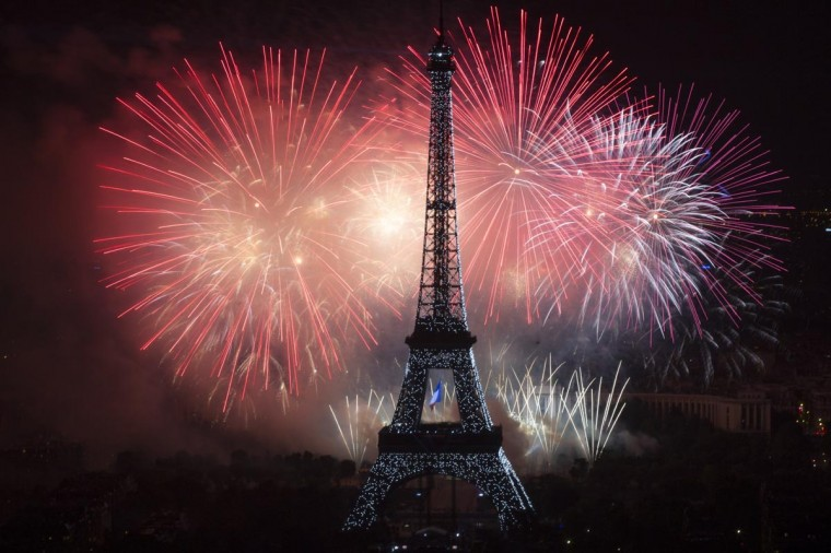 Fireworks burst around the Eiffel Tower in Paris on July 14, 2013 as part of France's annual Bastille Day celebrations. (Fred Dufour/AFP/Getty Images)