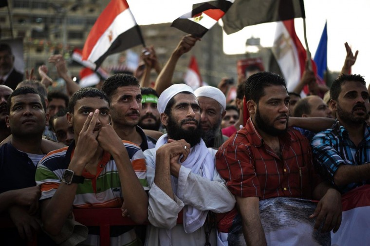 Muslim Brotherhood members and supporters of deposed president Mohammed Morsi take part in a rally outside Rabaa al-Adawiya mosque on July 15, 2013 in Cairo, Egypt. A top U.S. official pressed Egypt's interim leaders for a return to elected government after the army ousted Morsi, whose supporters massed to rally for his return. (Gianluigi Guercia/AFP/Getty Images)