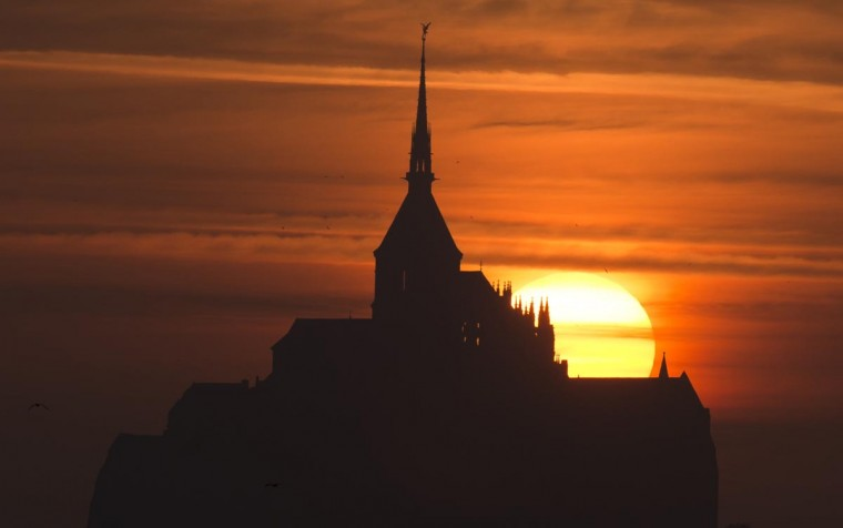 The sun sets on the Mont Saint-Michel, a Unesco world heritage site, western France on July 15, 2013. (Damien Meyer/AFP/Getty Images)