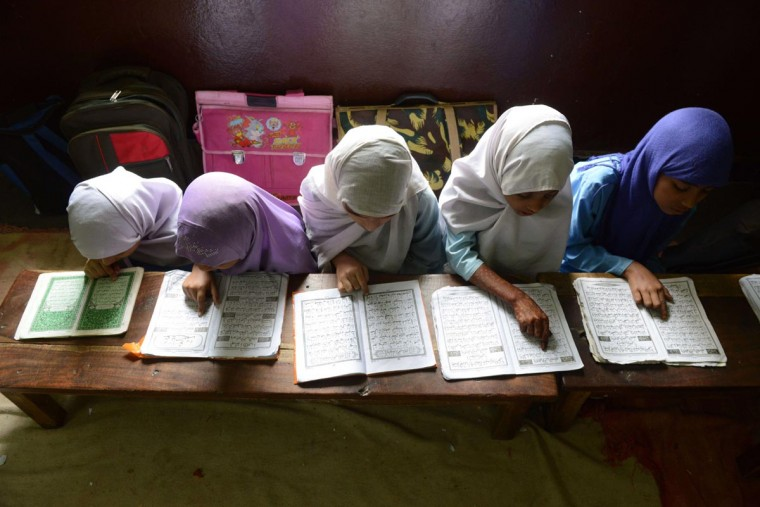 Indian Muslim girls recite the Holy Quran in their class room during the holy month of Ramadan at Madrasatur-Rashaad religious school in Hyderabad on July 17, 2013. As well as abstinence and fasting during Ramadan, Muslims are encouraged to pray and read the Quran during Islam's holiest month. (Noah Seelam/AFP/Getty Images)