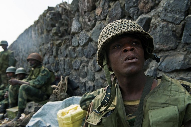 A Congolese army soldier reacts to shelling in Kanyarucinya, around 10km from Goma in the east of the Democratic Republic of the Congo on July 17, 2013. Heavy fighting resumed this afternoon, with artillery shelling and small arms combat in Kanyarucinya, and to the north, around Kibati. (Phil Moore/AFP/Getty Images)