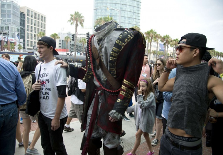 A person dressed as a headless man arrives at the Comic-Con International 2013 at the San Diego Convention Center in San Diego, California, on July 19, 2013. (Robyn Beck/AFP/Getty Images)