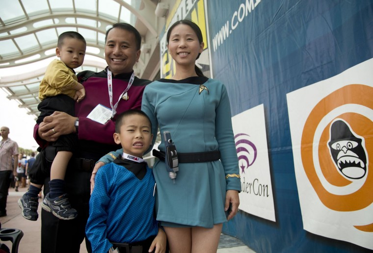 David Lee (second from left) poses with his wife Phuong Lee and their children Tyler (left) and Dillon in outfits from the Star Trek franchise, at the Comic-Con International 2013 at the San Diego Convention Center in San Diego California July 19, 2013. (Robyn Beck/AFP/Getty Images)