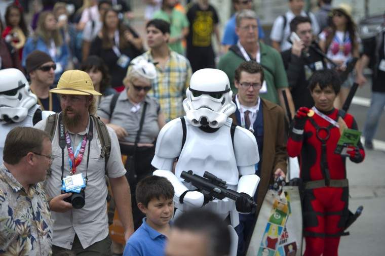 A Storm Trooper walks through the crowd outside Comic-Con 2013 in San Diego California July 19, 2013. Comic-Con is a four-day geekfest of pop culture attended by some 130,000 devotees of comic books, movies and TV shows -- many dressed up in the costumes of their idols. (Robyn Beck/AFP/Getty Images)