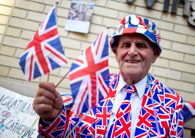 Royal supporter Terry Hutt poses for a picture outside The Lindo Wing of Saint Mary's Hospital in Paddington, west London on July 22, 2013. Prince William's wife Kate, (Catherine, Duchess of Cambridge) was admitted to hospital today in the early stages of labour as the world awaited the birth of a baby directly in line to inherit the British throne. (Andrew Cowie/AFP)