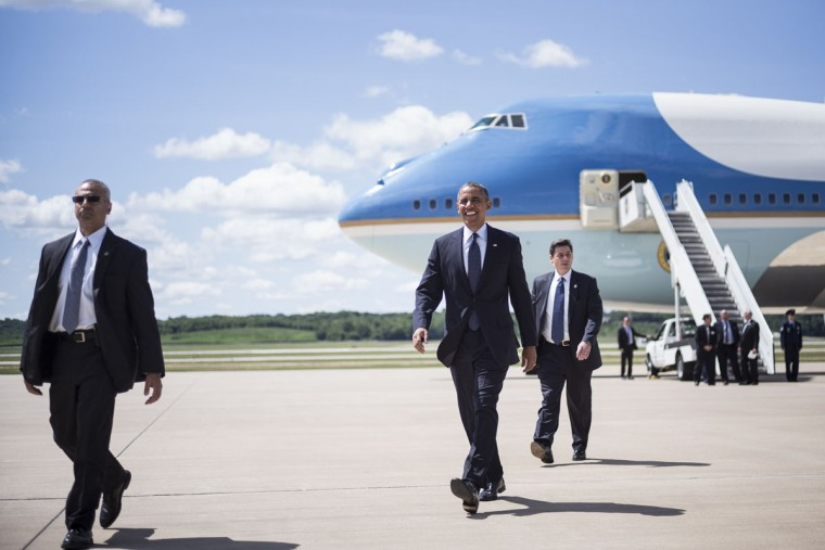U.S. President Barack Obama arrives at Quad Cities International Airport in Moline, Illinois. Obama is traveling to Illinois and Missouri to speak about the economy. (Brendan Smialowski/AFP/Getty Images)