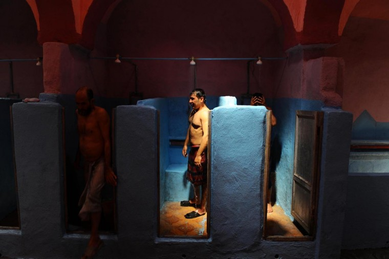 Afghan men wash at a traditional hamam bathhouse in Herat on July 25, 2013. Afghans usually come in the morning for one-hour sessions inside the steam-filled rooms, paying 50 Afghanis (1 USD) each. (Aref Karimi/AFP/Getty Images)