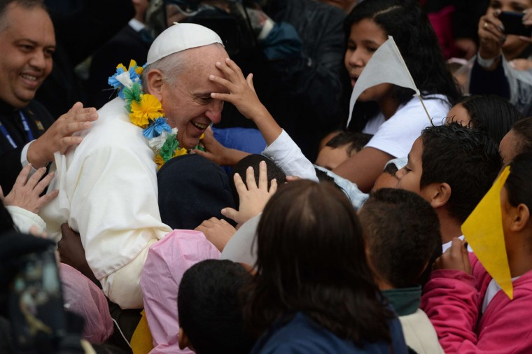 Pope Francis is surrounded by children as he strolls around during his visit to the Varginha favela in Rio de Janeiro, on July 25, 2013. The Varginha favela is a community of 1,000 people which for decades was under the sway of narco-traffickers until it came under police control less than a year ago. (Yasuyoshi Chibaya/AFP/Getty Images)