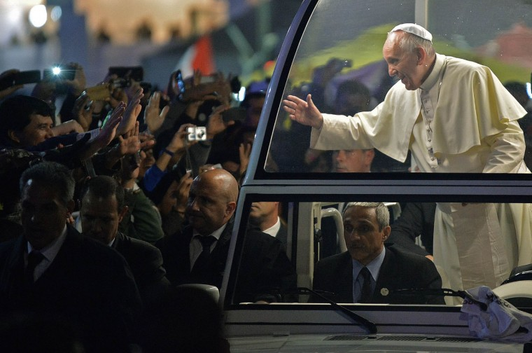 Pope Francis arrives on the popemobile at Rio de Janeiro's iconic Copacabana beachfront on July 25, 2013 for his welcome to World Youth Day ceremonies. (Nelson Almeida/AFP/Getty Images)