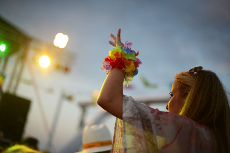 A woman dances during the Loveboat party of the Rotes Kliff club onboard the MS Dania ship in Hoernum of the north German Island of Sylt on July 25, 2013. The island of Sylt is known as a summer playground for the rich and famous in Germany. (Jens Kalaene/AFP/Getty Images)