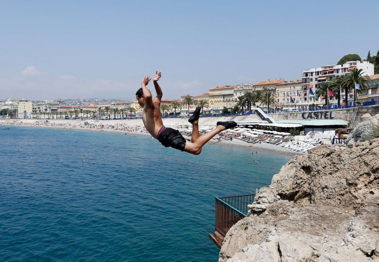 A child jumps in the Mediterranean Sea on July 26, 2013 in Nice, southeastern France. AFP PHOTO / VALERY (VALERY Hache/AFP/Getty Images)