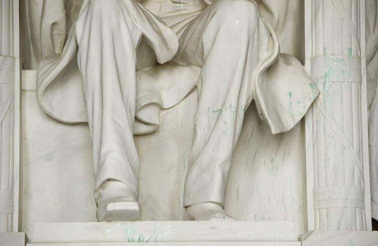 The Lincoln Memorial is covered in green paint on the National Mall in Washington, D.C., July 26, 2013. The splatter on the landmark larger-than-life statue of Abraham Lincoln was discovered overnight, said Captain Steven Booker, a spokesman for the U.S. Park Police. Criminal investigators are looking into the incident, including reviewing footage from security cameras, he said. (Saul Loeb/AFP/Getty Images)