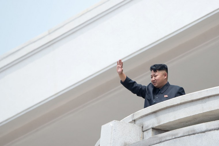 North Korean leader Kim Jong-un waves to the crowd during a military parade at Kim Il-sung Square marking the 60th anniversary of the Korean war armistice in Pyongyang. North Korea mounted its largest ever military parade on July 27, 2013 to mark the 60th anniversary of the armistice that ended fighting in the Korean War, displaying its long-range missiles at a ceremony presided over by leader Kim Jong-Un. (Ed Jones/AFP/Getty Images)
