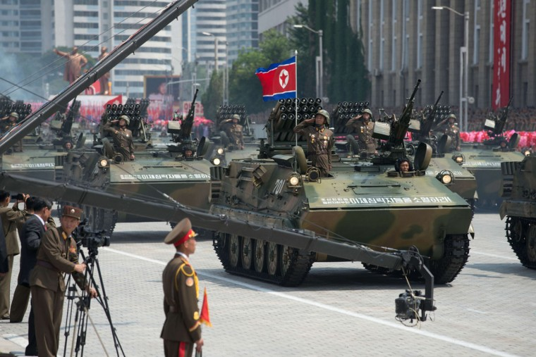 North Korean soldiers salute from a tank during a military parade past Kim Il-sung Square marking the 60th anniversary of the Korean war armistice in Pyongyang on July 27, 2013. North Korea mounted its largest ever military parade on July 27 to mark the 60th anniversary of the armistice that ended fighting in the Korean War, displaying its long-range missiles at a ceremony presided over by leader Kim Jong-un. (Ed Jones/AFP/Getty Images)