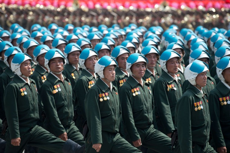 North Korean soldiers march during a military parade past Kim Il-Sung Square marking the 60th anniversary of the Korean war armistice in Pyongyang on July 27, 2013. North Korea mounted its largest ever military parade on July 27 to mark the 60th anniversary of the armistice that ended fighting in the Korean War, displaying its long-range missiles at a ceremony presided over by leader Kim Jong-un. (Ed Jones/AFP/Getty Images)