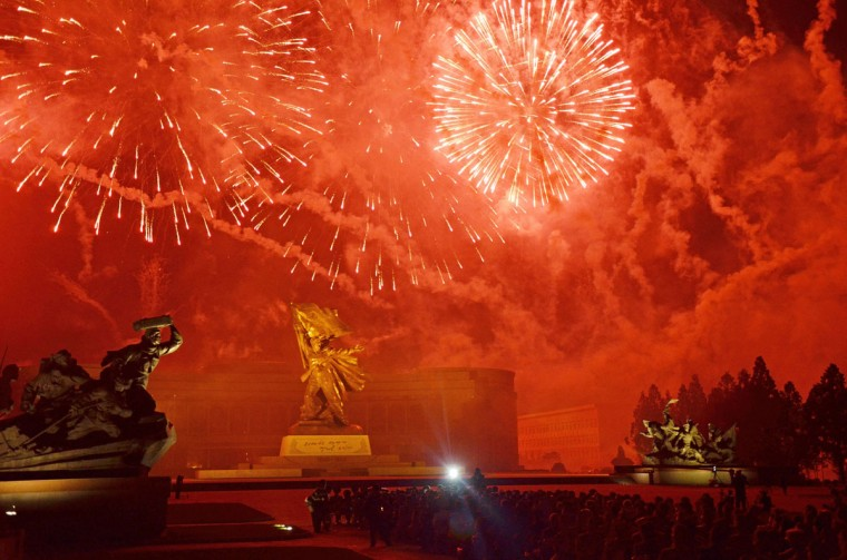 """Fireworks explode in front of the """"Victorious Fatherland War Museum"""" during a display marking the 60th anniversary of the Korean war armistice agreement, in Pyongyang on July 27, 2013. North Korea mounted its largest ever military parade to mark the 60th anniversary of the armistice that ended fighting in the Korean War, displaying its long-range missiles at a ceremony presided over by leader Kim Jong-un. (Giles Hewitt/AFP/Getty Images)"""