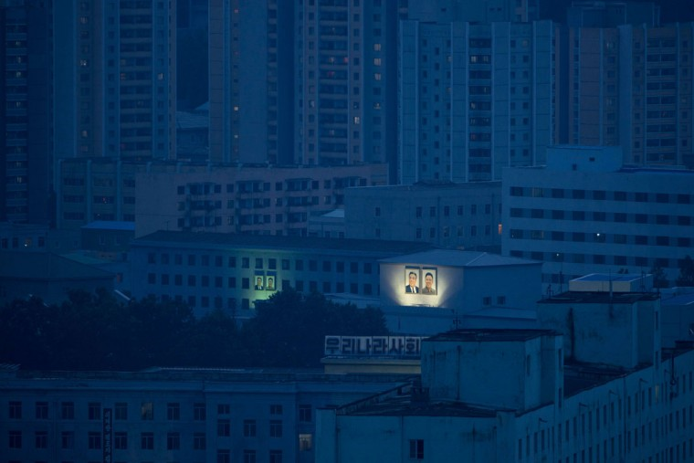 Portraits of former North Korean leaders Kim Il-sung and Kim Jong-il are displayed on buildings of the Pyongyang skyline on July 27, 2013. North Korea mounted its largest ever military parade to mark the 60th anniversary of the armistice that ended fighting in the Korean War, displaying its long-range missiles at a ceremony presided over by leader Kim Jong-un. (Ed Jones/AFP/Getty Images)
