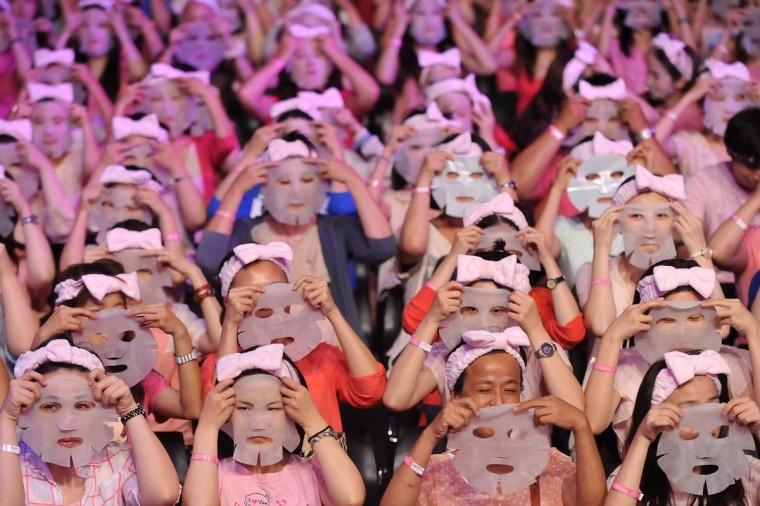 Participants get ready to apply facial masks on their faces in Taipei on July 28, 2013. Some 1,213 people reportedly broke the Guinness World Record by applying facial masks for 10 minutes at the same time in an event organized by a local face mask company. (Mandy Cheng/AFP/Getty Images)