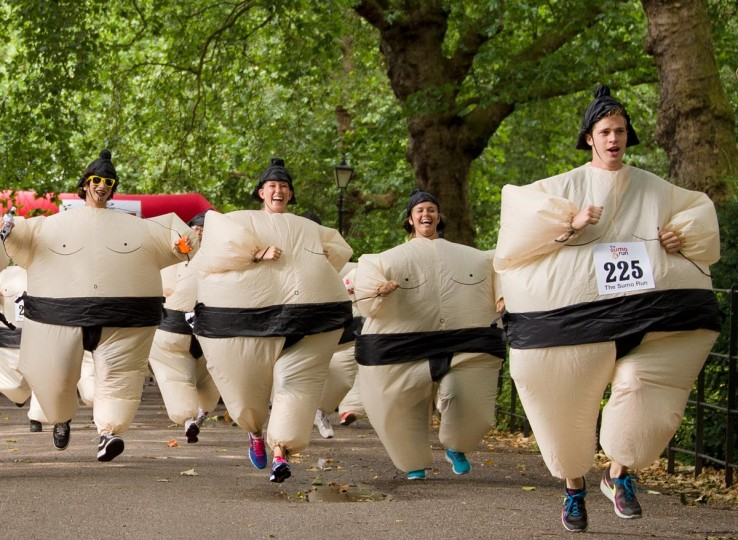 Participants take part in The Sumo Run in Battesea Park, west London, on July 28, 2013. The Sumo Run is an annual 5km charity fun run around the park in inflatable Sumo Suits. The event previously set a Guinness World Record for the largest gathering of people running in Sumo Suits. (Leon Neal/AFP/Getty Images)