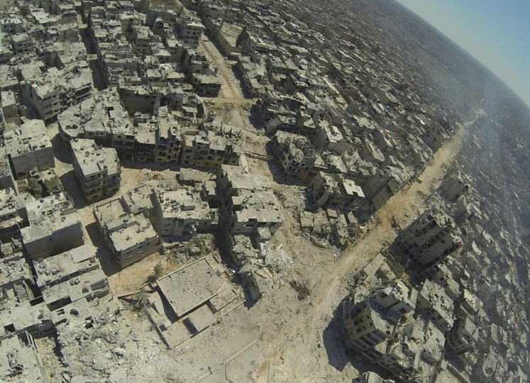 An aerial view of destruction is seen in the al-Khalidiyah neighborhood of the central Syrian city of Homs July 29, 2013. Government forces bolstered by Lebanese Shiite militiamen were poised to retake the largest rebel-held district of Syria's third city Homs, a watchdog and state media said. (Shaam News Newtwork Handout photo via AFP)