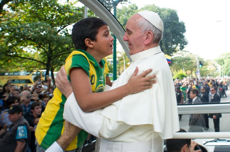 Pope Francis hugs a boy at Quinta da Boa Vista Park in Rio de Janeiro, Brazil, on July 26, 2013. Pope Francis returned to Rome late Sunday after leading a giant beach mass in Brazil for three million pilgrims, ending his historic trip to reignite Catholic passion with pleas for a humbler Church. (Luca Zennaro/AFP/Getty Images)