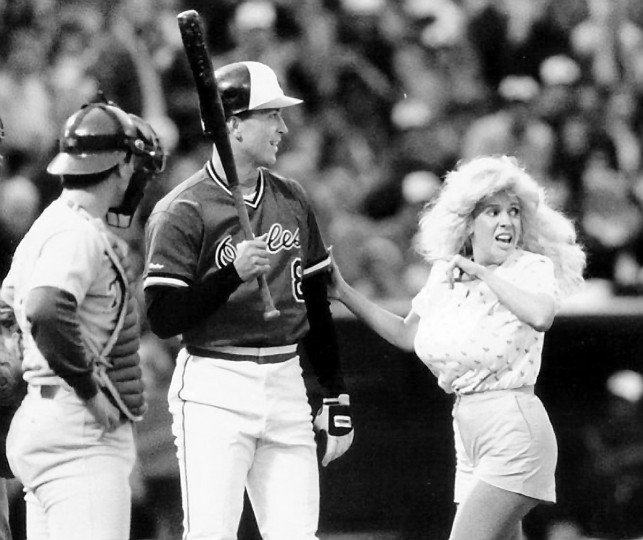 "Morganna Rose Roberts, also known as ""the kissing bandit,"" is shown kissing Cal Ripken Jr/ at home plate on May 2, 1988. (Gene Sweeney Jr/Baltimore Sun)"