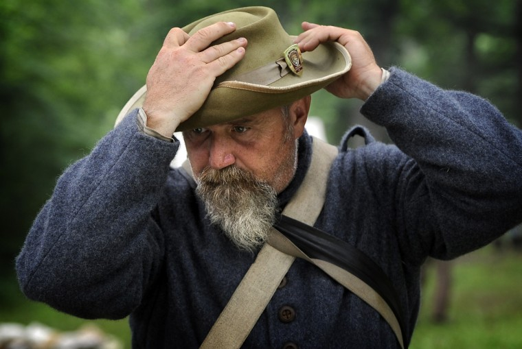 Jake Nott, portraying a Confederate soldier in the 4th Virginia Company, adjusts his hat at the 150th anniversary of the Battle of Gettysburg. (Barbara Haddock Taylor/Baltimore Sun)