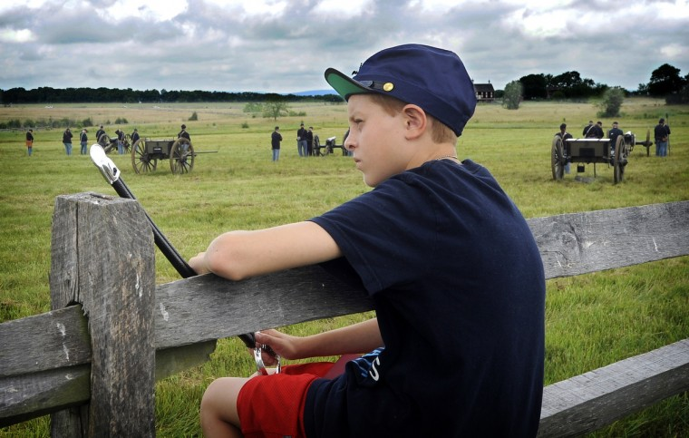 Xavier Serrano, 11, of Millsboro, Delaware, watches as Union troops do a demonstration of artillery at the 150th anniversary of the Battle of Gettysburg. (Barbara Haddock Taylor/Baltimore Sun)