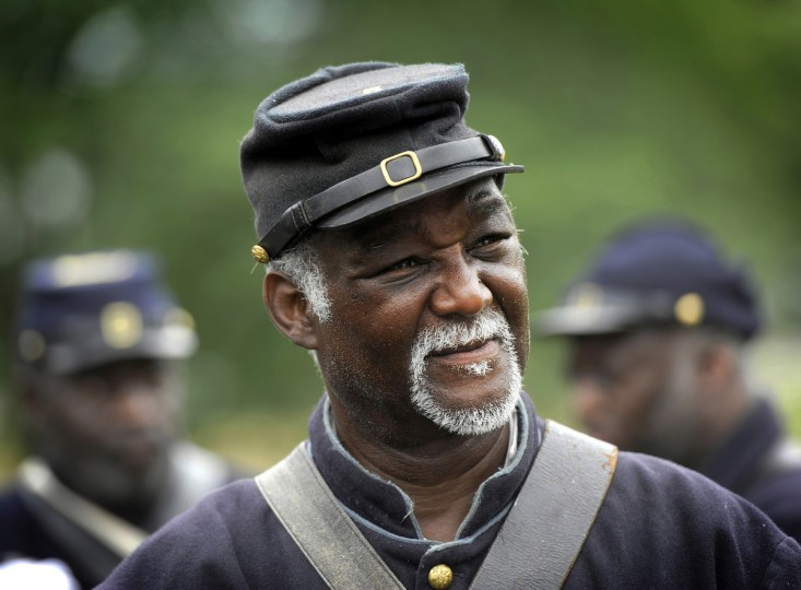 Joe Becton of Philadelphia, who is with the 3rd Regiment of U.S. Colored Troops, stands with fellow soldiers at the 150th anniversary of the Battle of Gettysburg. (Barbara Haddock Taylor/Baltimore Sun)