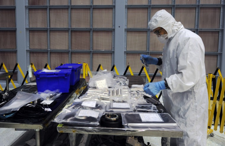 A contractor examines support equipment recently delivered to the Clean Room of NASA Goddard Space Flight Center where the James Webb Space Telescope is being built. (Algerina Perna/Baltimore Sun)