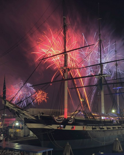 Fireworks rise behind the U.S.S. Constellation during the Fourth of July Independence Day 2013 celebration at Harborplace Thursday, J(Karl Merton Ferron/Baltimore Sun)