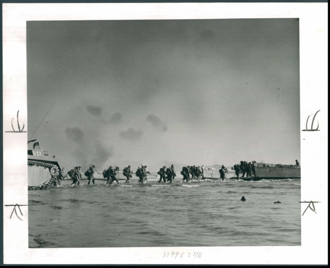 Published January 28, 1951: Troops wade out to a landing craft at Hungnam. (James M. Cannon/Baltimore Sun)