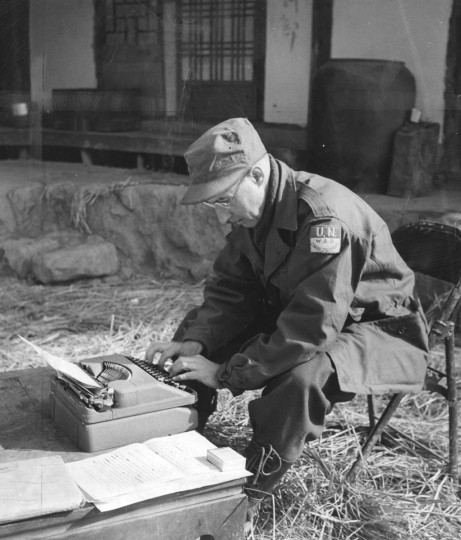 John T. Ward, Sunpapers War Correspondent writes a dispatch outside 2nd Div. HQ February 1951. (Baltimore Sun)