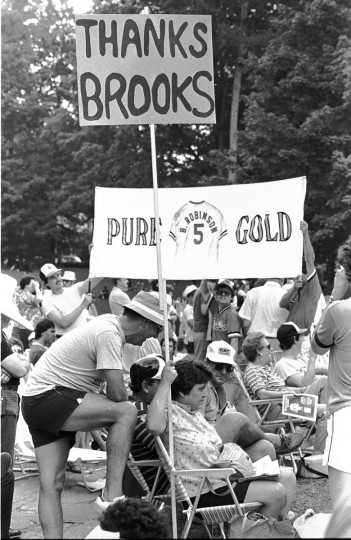Brooks Robinson fans wait for the Orioles third baseman's induction into the Baseball Hall of Fame in 1983. (Gene Sweeney Jr./Baltimore Sun)