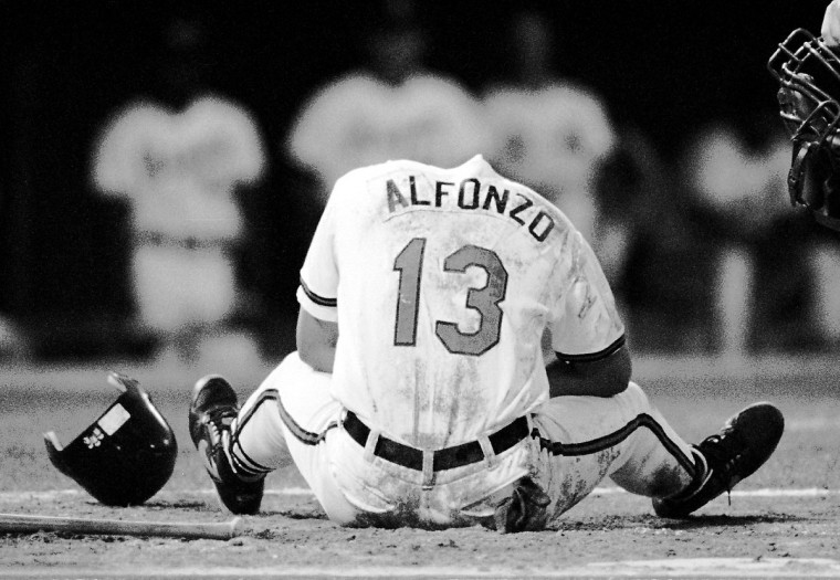 Bowie Baysox batter Edgar Alfonzo appears to have lost his head as he was hit inand around the high chest area by Phillies pitcher Greg Brown in a June 1993 game. Much to the relief of all, his head was intact, and after some attention by the trainer, he took first base. (Gene Sweeney Jr./Baltimore Sun)