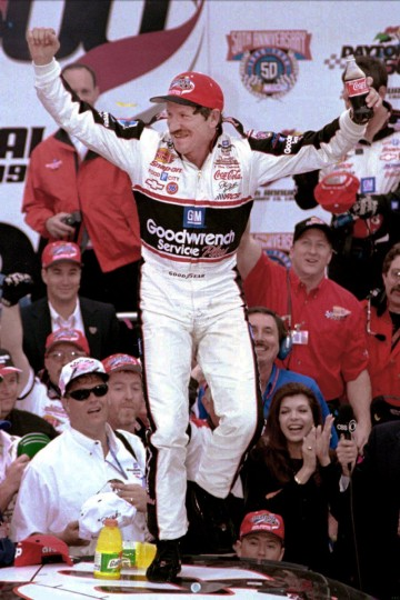 Dale Earnhardt leaps on the roof of his car in victory lane after 20 years of frustration ended when he won The Daytona 500 in Daytona Beach, Fla., on Feb. 15, 1998. (Gene Sweeney Jr./Baltimore Sun)