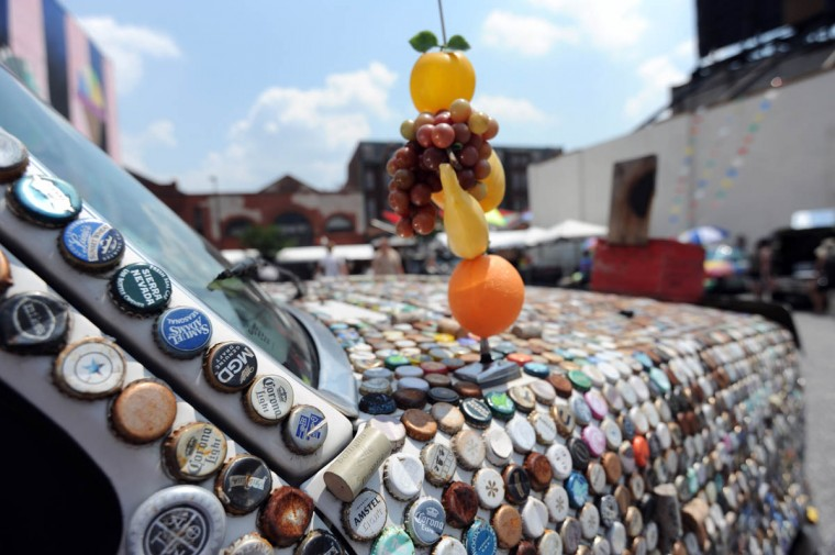 An art car decorated with bottle caps and wine corks at the 20th anniversary of Artscape's art car show. (Kim Hairston/The Baltimore Sun)