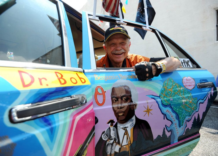 "Dr. Bob Hieronimus shows off one of the panels on his biodiesel ""We The People"" Artcar which has an image of Benjamin Banneker, astronomer and surveyor of Washington, DC. This is the 20th anniversary of Artscape's art car show. (Kim Hairston/The Baltimore Sun)"