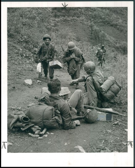 Published August 1951: Supplies are toted up a mountain in Korea. (John T. Ward and James M. Cannon/Baltimore Sun)