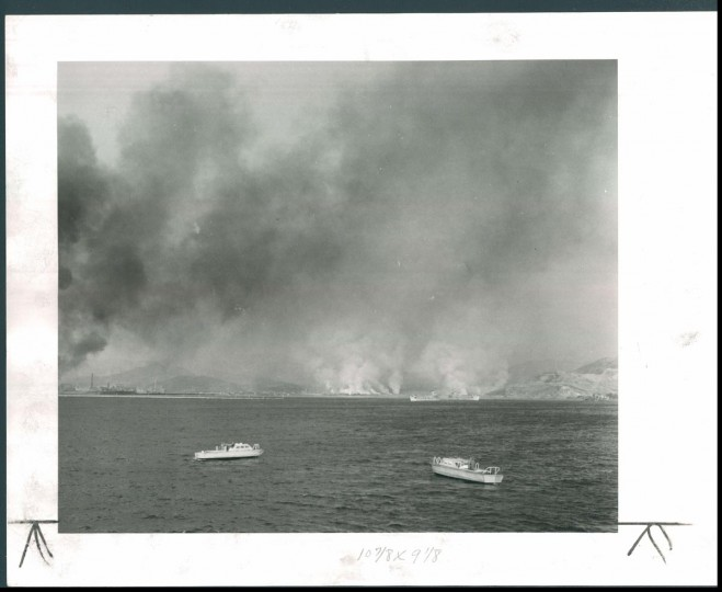 Published January 1951: Demolition fire shroud Hungnam in smoke during the withdrawal of American forces from that Korean beachhead. (James M. Cannon/Baltimore Sun)