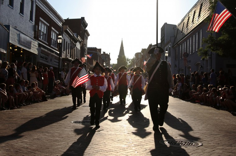 Participants of the Annapolis Fourth of July Parade march down Main Street. (Erin Kirkland/Baltimore Sun)