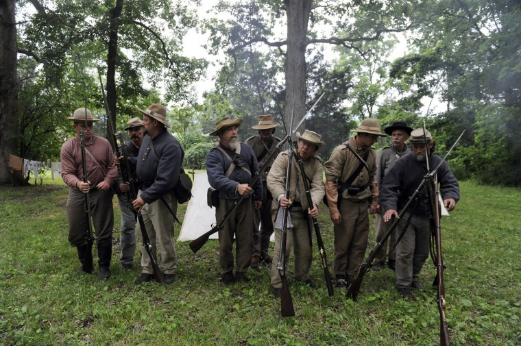 Confederate re-enactors portraying the 4th Virginia Company gather at one of the living history encampments at the 150th anniversary of the Battle of Gettysburg. (Barbara Haddock Taylor/Baltimore Sun)