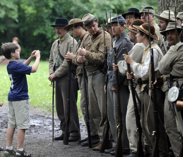 Maxim Bielaszka-DuVernay of Sparks MD, left, takes a photo of a Confederate regiment at the 150th anniversary of the Battle of Gettysburg. (Barbara Haddock Taylor/Baltimore Sun)