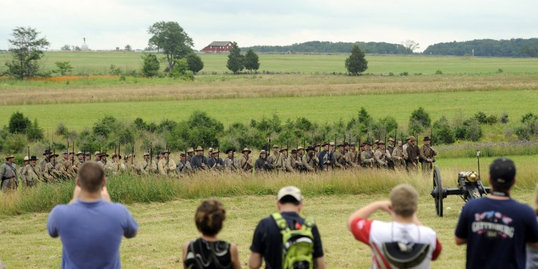National Park visitors watch a Confederate infantry demonstration at the 150th anniversary of the Battle of Gettysburg. (Barbara Haddock Taylor/Baltimore Sun)