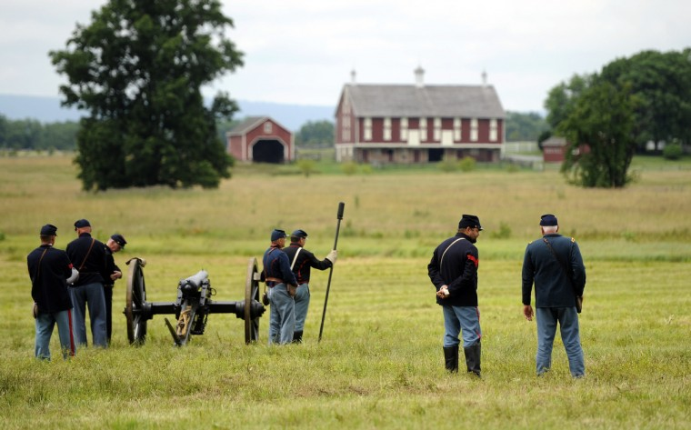 Union Artillery soldiers take a break between firing their canon at the 150th anniversary of the Battle of Gettysburg. (Barbara Haddock Taylor/Baltimore Sun)