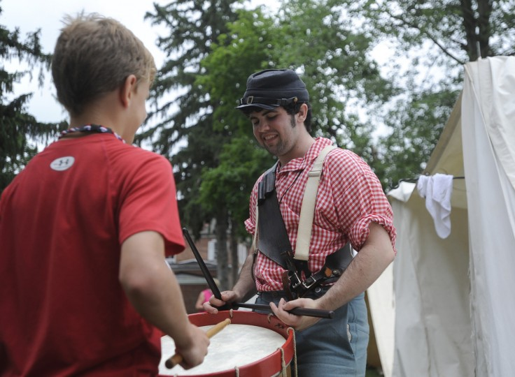 John Bryner, 12, left, gets a lesson in Civil War drumming from musician Johnny Chapman, right, of Lockport NY. Mr. Chapman is from the Reynolds' Battery 1st New York Light Artillery brigade and was performing at the 150th anniversary of the Battle of Gettysburg. (Barbara Haddock Taylor/Baltimore Sun)