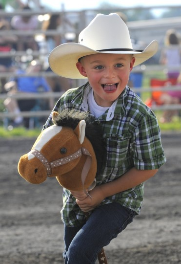 Michael Wynkoop, 5, of Smithsburg, Md., plays with a stick horse before the bull riding event. (Lloyd Fox/Baltimore Sun)